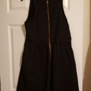 Black cocktail dress with pockets and back zipper
